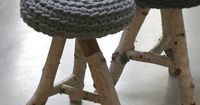 beautiful marriage of wool (the colour grey is so apt) and raw wood - reminds me of my vintage stool that I nailed a piece of grey felt onto as a seat!