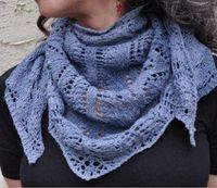 This pretty knit shawl pattern is a gorgeous shade of blue and is perfect for year-round wear. The best part about the Blue Jeans and Moon Beams Shawl is how ve