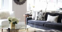 lucite, velvet bench, smoky gray/blue sofa w/chocolate printed pillow & complementary white sofa...divine!