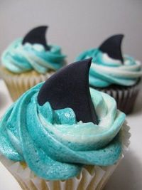 shark cupcakes, how cute. Some of you know my fascination with sharks, so I'll be making these for Shark Week in August!