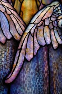 Tiffany Glass Wings. Note the patterns in the glass pieces. They were created to give a sense of depth and texture and then used almost as paint to create the image. See the striations on the feathers? The chain mail of the skirt? The play of swirls in th...