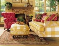 Love the buffalo check and toile fabrics on the sofa..... Pop of red.. Perfect..