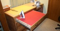Pull out ironing board drawer. This would be nice for many craft projects.