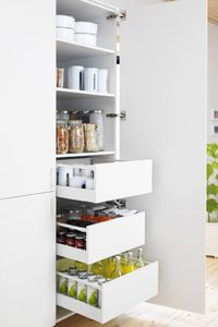 Full wall of pull-out drawers for pantry