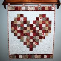 Valentines heart quilt / wall hanging. Personally I'd use pinks, maroons, and more red materials.