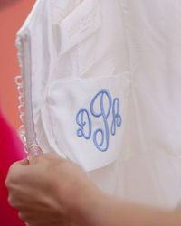 I love this idea for something blue! She sewed her pre-wedding monogram in blue silk into her wedding dress.