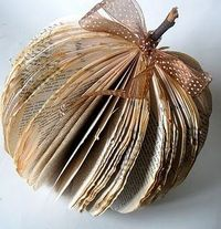 This is fashioned after a tutorial in Country Living magazine for making a vase shape decoration from an old book. The pumpkin is even cuter! Great way to reuse and recycle an old book that is not read anymore.