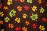Patrick Lose Fabrics / Autumn Palette / Leaves on Brown Background $8.99