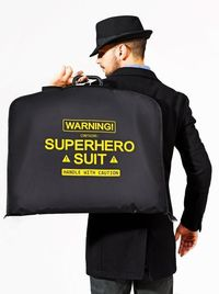 Warning! Contains: Superhero Suit. Handle with caution.