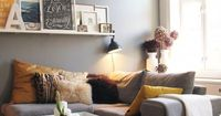 Yellow and grey living room- I love the pictures on the shelf.