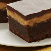 Extreme Fudgy Peanut Butter Brownies: An all American favorite, to the extreme: a milk-chocolate brownie layer loaded with chocolate chips, covered with fluffy peanut butter, then topped off with a final layer of chocolate.