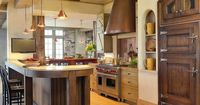 Kitchen Ideas: Design Styles and Layout Options : Kitchen Remodeling : HGTV Remodels Love the built-in Fridge and the range hood is gorgeous. Elegant and Rustic at the same time.