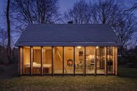 This recreational compact house is located in the countryside in Utrecht, Netherlands. The project is the result of the collaboration between the Zecc Architects and the interior designer Roel van Norel.