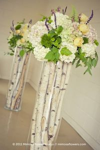 birch branches and flowers in glass cylinders
