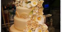 Four-Tier Ivory and Gold Wedding Cake with Flowers