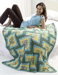 Create a Crochet Granny Afghan and keep it for a warm night next to the fire. Super Saver yarn makes this free crochet afghan pattern nice and warm. This patter