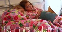 The mini snuglet (aka snuggie), with link to pattern and directions.