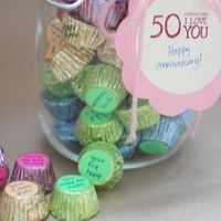 50 Reasons I Love You (Anniversary Gift)Check out this thoughtful and inexpensive way to tell your honey you love him. Take 50 mini peanut butter cups, stick a