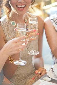 lace dresses, champagne toast and champagne.