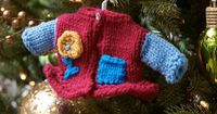 Girlie Fashion Sweater Ornament - free Knitting Pattern | Red Heart; Knit a sweater for the tree! This darling sweater has a girlie look and is a nice gift
