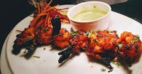 Tandoori prawns ( spicy shrimp ) is made by marinating with tandoori masala and cook till crisp golden. Serve with cilantro mint sauce or green chutney.