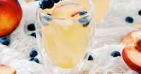 A recipe for the perfect summer Peach Gin Fizz by Jacquelyn Clark of Lark & Linen.