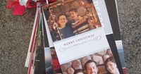 Christmas card organization - punch a hole in the upper-left-hand corner and secure with binding ring