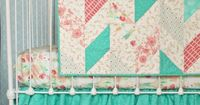 Vintage inspired florals in modern color palette of mint green , coral and peach! Herringbone quilt bumperless bedding set.