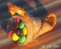 Must remember for Thanksgiving next year! Dip tip of waffle cone in warm water for about 20 seconds then microwave for 20 seconds. Roll the softened end of the cone around a clean pencil then hold in place for 20 seconds. Little cornucopias.