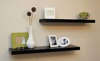 I want some of these black shelves in my room....dark Cherry wood with chocolate and green colors.