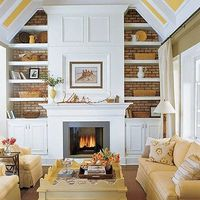 Built-in shelving, fireplace and vaulted ceiling.