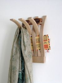 Wall mounted organizer to hang and hold personal items, made from bent wood lamination in maple.