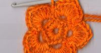Applehead has a complete tutorial on how to crochet a basic five petal flower. This is a great pictoral step-by-step reference for those that don't crochet