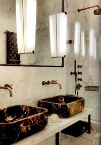jeffreyalanmarks:.. an amazing display of marble. The marble sinks are designed by Colin Cuarto and are the perfect complement to the fixtures. Check out those sconces, reclaimed from an Italian Hotel. Molto bello!