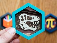 "Paper shadow box version of the Paleontologist skill patch from DIY.org. 3"" tall, .5"" thick. Original artwork by Isaiah Saxon. Buy the embroidered patch here."