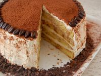 Turn your favorite Italian restaurant treat into a spectacular cake, starting with a cake mix and coffee. This is a great make-ahead recipe, since the cake tast