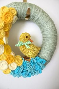 easter wreaths, yarn wreaths and yellow flowers.