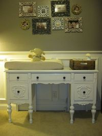 a vintage desk for a changing table! LOVE this! And the photos & old crate for changing table supplies