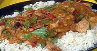 Get this all-star, easy-to-follow Chicken Satay Stir-Fry with Orange Scented Jasmine Rice recipe from Rachael Ray