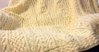 This is my original pattern for a one-of-a-kind heirloom afghan. The pattern contains several traditional Irish knitting motifs - fancy twisted cables, nested hearts, bobbles, and braids. This project is knit in 5 pieces and seamed together at the end for...