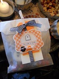 Michelle Wooderson (Mish Mash Blog) uses glassine bags, tags, ribbon, clothespins (usually glitter!!! :)), stamps, twine, buttons - LOVE! and I'm not even a Halloween girl!