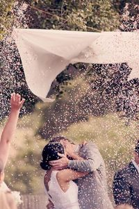 A rose petal drop at your wedding ceremony lends a romantic touch to your special day; however, you first need to check with your wedding venue to make sure you