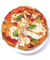 Baking the pizza on an oiled pan makes the crust extra golden and delicious. Get the recipe for margherita pizza.
