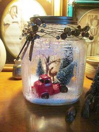 Took a vintage cookie jar sprayed adhesive inside poured some snow inside ,shook, and used Epsom salt for the snow drifts, decorated inside and out :) Happy sea
