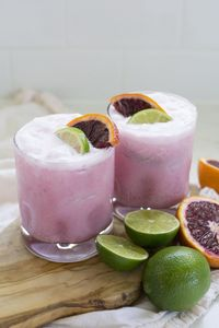 Delicious and creamy coconut and blood orange margaritas with lime make the prettiest pink cocktails. Perfect for a girls night!