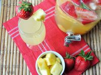 """This fruity & bubbly Strawberry-Pineapple """"Sans""""gria is the perfect kid friendly drink to serve for a spring brunch or summer BBQ! Adults can add a splash of wh"""