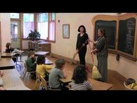 "This is a video of Waldorf Handwork Teachers demonstrating how to cast on and knit to the a 1st grade class using a song/rhyme. Cast on: ""In through the front door run around the back peak through the window, let go, Jack grows and jumps on the stack...."