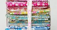 love these fabric bundles; spendy here but, if i put them together in india, oh what fun that would be!