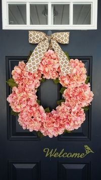 Decorate your front door, home, or even wedding ceremony with this beautiful hydrangea wreath! This wreath is made from an 18 inch natural grapevine base, 8 beautiful, realistic, peachy pink - coral colored hydrangea blooms along with realistic leaves. Ca...