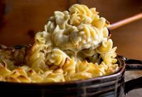 Mascarpone, Brie, cream cheese and Parmesan yield the most velvety macaroni and cheese imaginable This is perfect for a wintry dinner, with a green salad on the